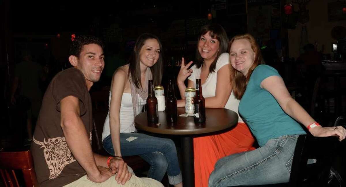 Lawrence Monltalto (from left), Amanda Liarakos, Ashley Moore and Candice Cantrelle buy another round at Dixie's Bar and Patio. ROBIN JOHNSON / SPECIAL TO THE EXPRESS-NEWS