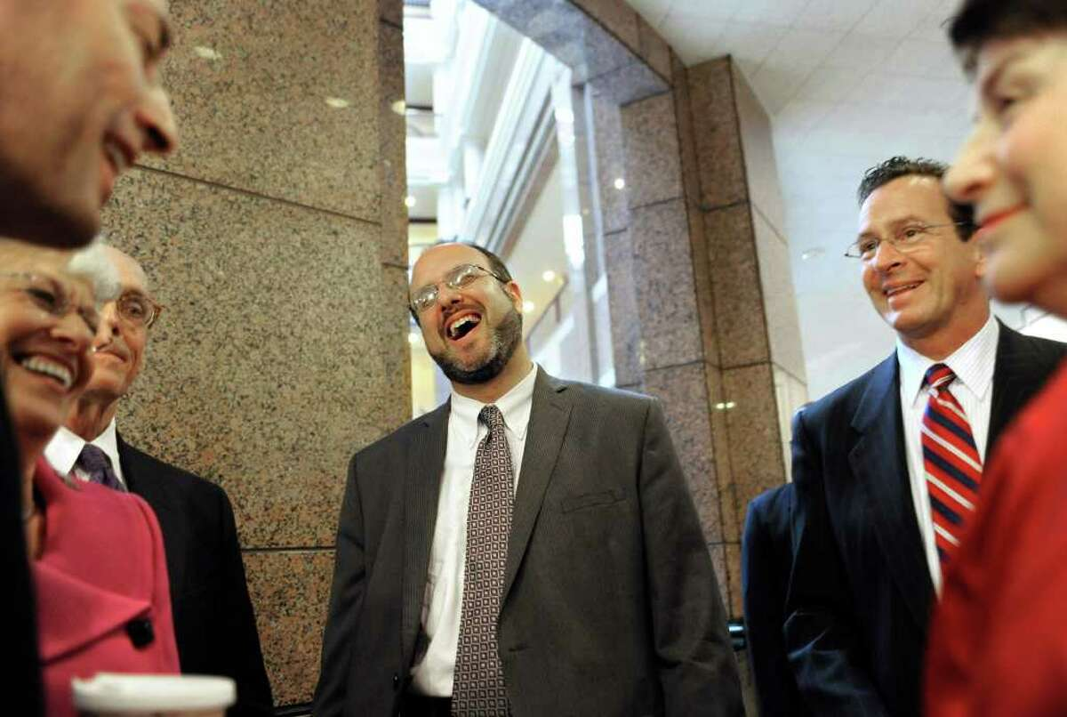 New State Department of Education Commissioner Stefan Pryor, center, laughs as he waits to be introduced at a news conference by Gov. Dannel P. Malloy, second from right, at the Legislative Office Building in Hartford, Conn., Wednesday, Sept. 7, 2011. (AP Photo/Jessica Hill)