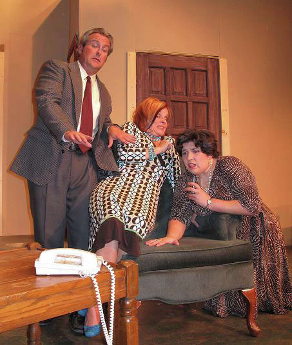 Jeff Fowler (from left), Joy Lindsey and Robin Williams appear in the Circle Arts Theatre's 'Funny Money.' Courtesy of the Circle Arts Theatre