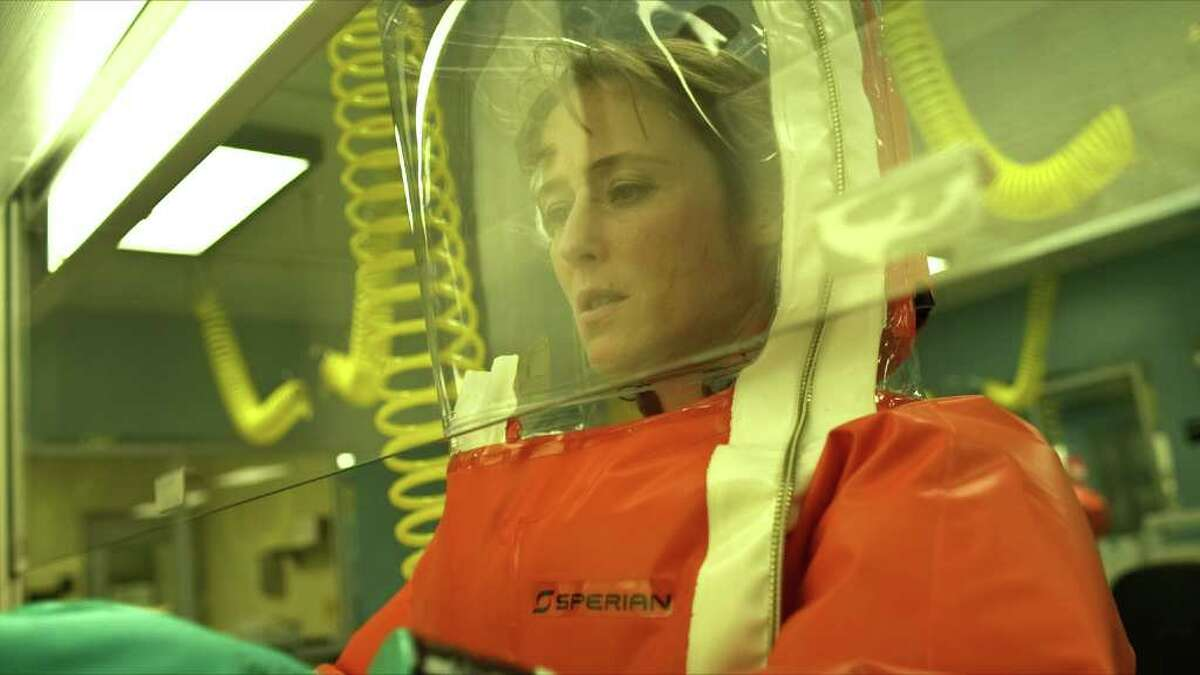 """Dr Ally Hextail (Jennifer Ehle) struggles to find a vaccine for a deadly pathogen in """"Contagion."""" WARNER BROS. PICTURES"""