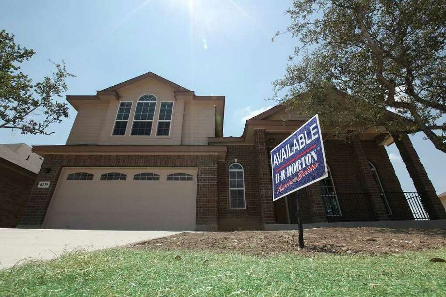 "A ""For Sale"" sign is seen on a DR Horton home in the Alamo Ranch area of Northwest San Antonio. Photo: JERRY LARA, San Antonio Express-News / SAN ANTONIO EXPRESS-NEWS"