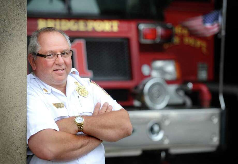 Bridgeport Assistant Fire Chief Dominick Carfi stands in the bay at the Brigeport Fire Department Wednesday, Sept. 7, 2011.  Carfi volunteered at ground zero on Sept. 12, 2001.   He was diagnosed with multiple myeloma in 2009 and is not sure if it is related to his work at the scene. Photo: Autumn Driscoll / Connecticut Post
