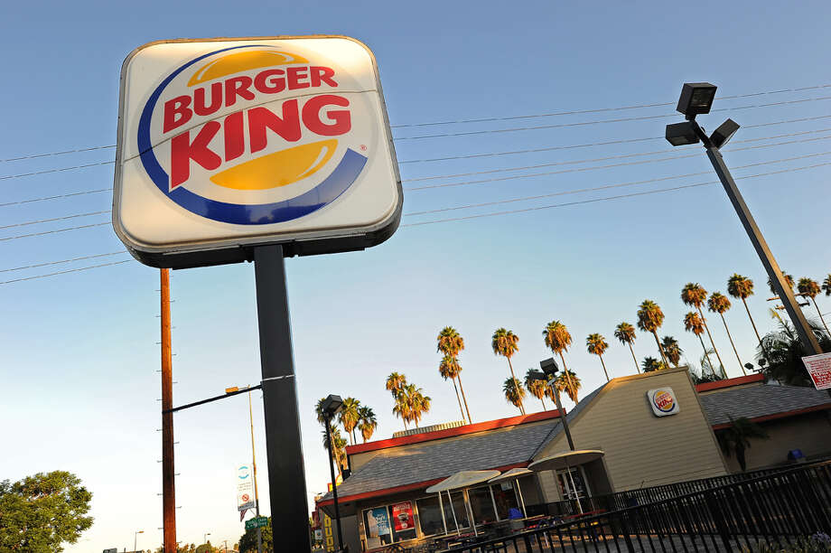 "Washington Department of Health staff sent a Sept. 1 letter to Burger King regarding ""a disturbing trend"" regarding undercooking burgers. A company spokeswoman told seattlepi.com Washington franchise owners are ""taking immediate action to ensure that their restaurants are meeting the company's stringent food preparation procedures."" Photo: Robyn Beck/AFP/Getty Images, AFP/Getty Images / AFP"