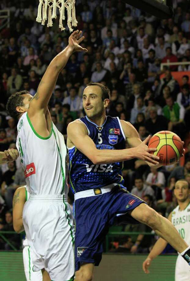 Argenatina's Manu Ginobili, right, goes up for a shot against Brazil's  Rafael Hettsheimer during a FIBA Americas Championship basketball game in Mar del Plata, Argentina, Wednesday, Sept. 7, 2011. The top two finishers of the tournament get an automatic berth in the 2012 London Olympics and the next three advance to the last-chance Olympic qualifier to be held in July 2012. Photo: Martin Mejia/Associated Press