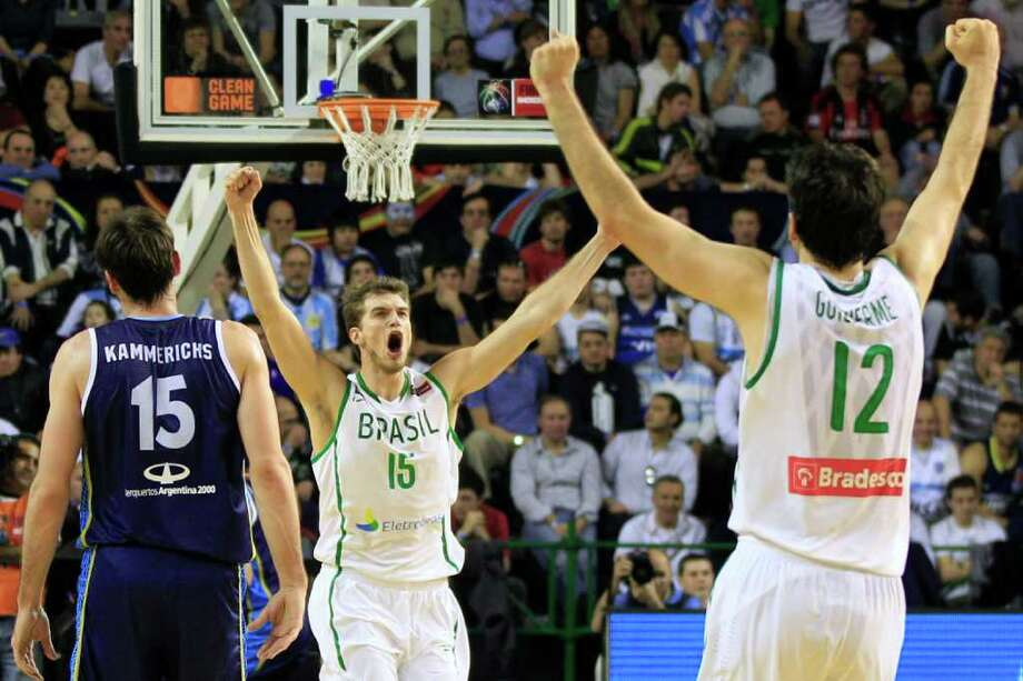 Brazil's  players Tiago Splitter, center, and Guilherme Giovannoni, right, celebrate after scoring as Argentina's Guillermo Kammerichs, left, reacts during a FIBA Americas Championship basketball game in Mar del Plata, Argentina, Wednesday, Sept. 7, 2011. The top two finishers of the tournament get an automatic berth in the 2012 London Olympics and the next three advance to the last-chance Olympic qualifier to be held in July 2012. Photo: Martin Mejia/Associated Press