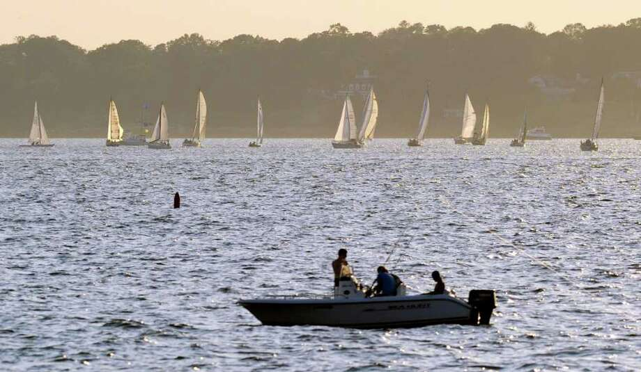 Sailboats on Long Island Sound, Wednesday night, Aug. 17, 2011. Photo: Bob Luckey, Greenwich Time / Greenwich Time