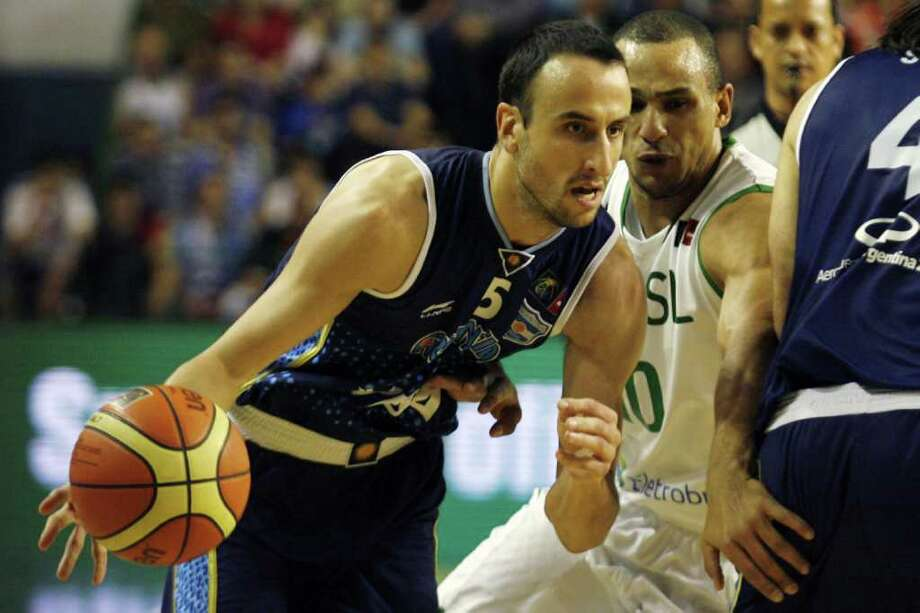 Argentina's Manu Ginobili (left) drives past Brazil's Alex Garcia of Brazil during the qualifying round match of the 2011 FIBA Americas Championship on Wednesday, Sept. 7, 2011 at Islas Malvinas Stadium, Mar del Plata, Buenos Aires, Argentina. Photo: Maxi Failla/AFP/Getty Images / 2011 AFP