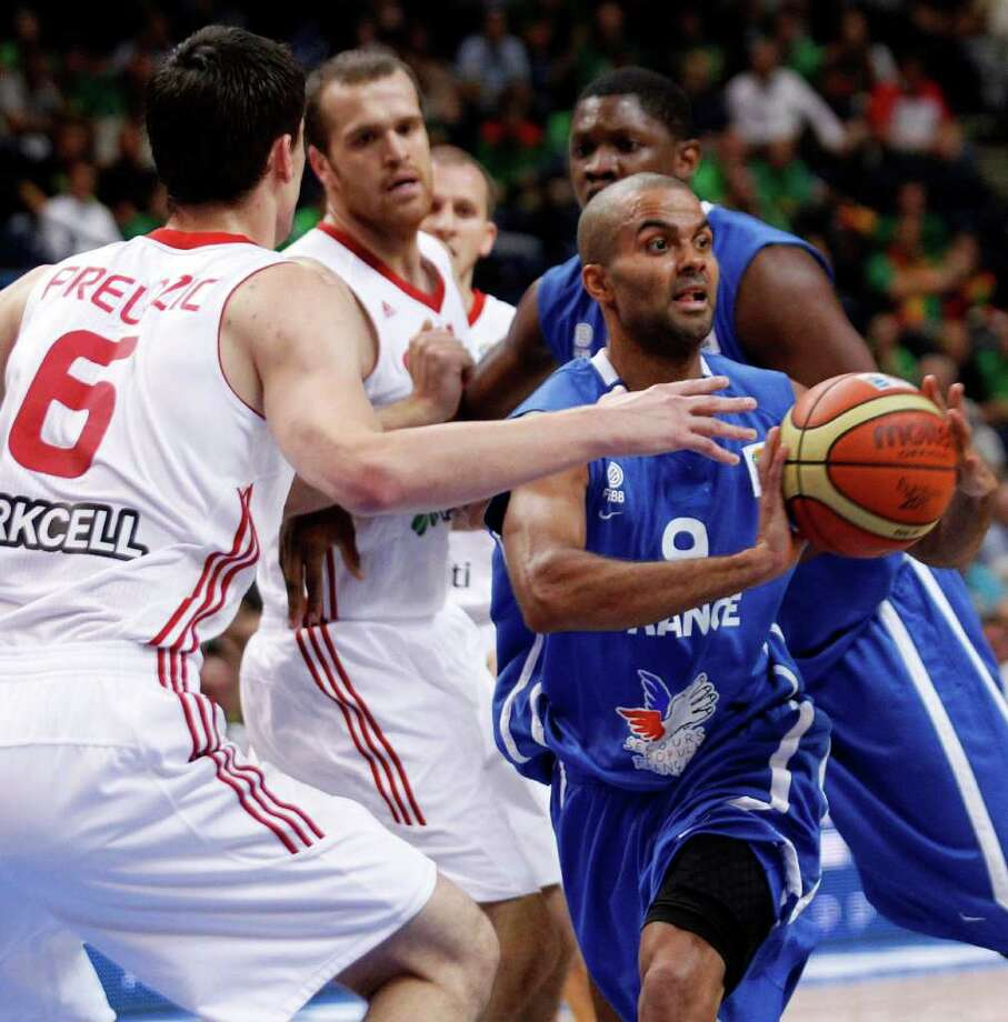 Tony Parker, right, of France is challenged by Emir Preldzic, left, from Turkey  during the EuroBasket 2011, European Basketball Championships group E match between Turkey and France in Vilnius, Lithuania, on Wednesday, Sept. 7, 2011. Photo: Mindaugas Kulbis/Associated Press / AP