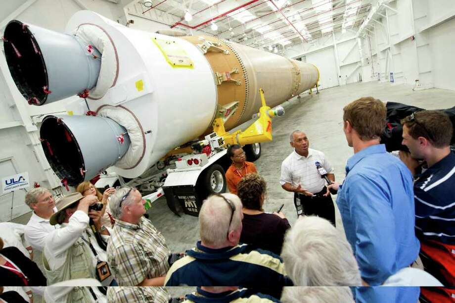 NASA Administrator Charles Bolden, stands in front of the Atlas V first stage booster while taking questions from the media, Wednesday, Sept. 7, 2011, at the Cape Canaveral Air Force Station in Cape Canaveral, Fla. The rocket, powered by a Pratt & Whitney Rocketdyne engine, will help send NASA's Mars Science Laboratory Project's Curiosity rover to Mars later this year. (AP Photo/NASA - Bill Ingalls) Photo: Bill Ingalls, AP / (NASA/Bill Ingalls)