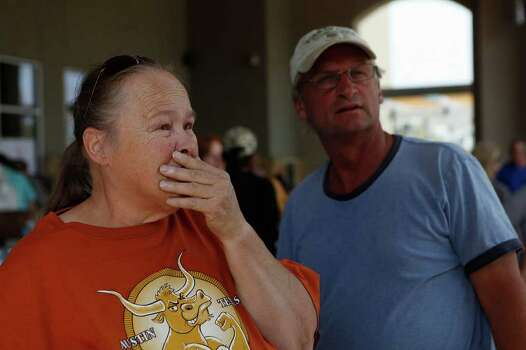 Linda Erwin, next to Al Lang, cries tears of relief at not seeing her address listed on lists of addresses with confirmed structure losses  as residents try to find out the status of their homes at the Convention Center in Bastrop on Wednesday, Sept. 7, 2011. She lives in the area where the fire started, at Hwy 21 and Cardinal Loop. Photo: LISA KRANTZ, Lisa Krantz/lkrantz@express-news.net / SAN ANTONIO EXPRESS-NEWS