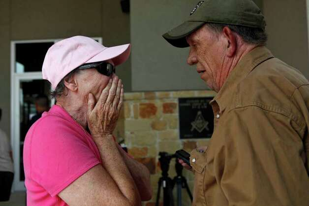 Carl and Susan Miller cry tears of joy as they find out their two miniature horses, Sonny and Smokey, are alive although their home was destroyed, via a phone call from a co-worker who was able to check on the Miller's home, at the Convention Center in Bastrop on Wednesday, Sept. 7, 2011. Photo: LISA KRANTZ, Lisa Krantz/lkrantz@express-news.net / SAN ANTONIO EXPRESS-NEWS