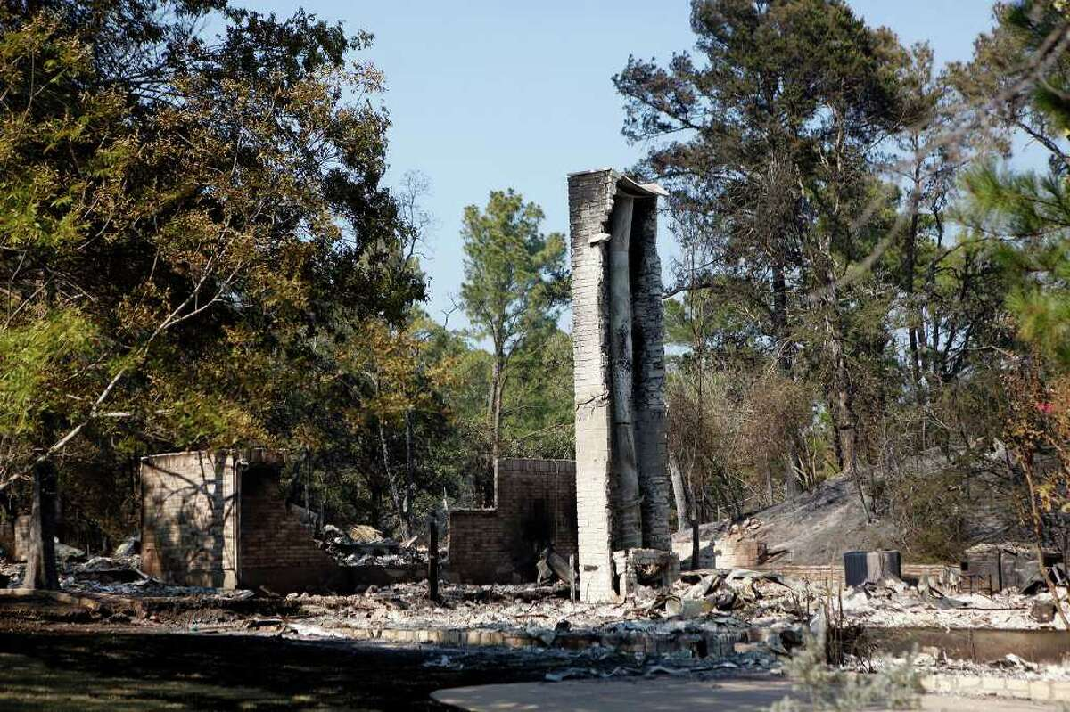 A chimney is all that's left of a home destroyed by the wildfire in the Tahitian Village subdivision in Bastrop on Wednesday, Sept. 7, 2011.