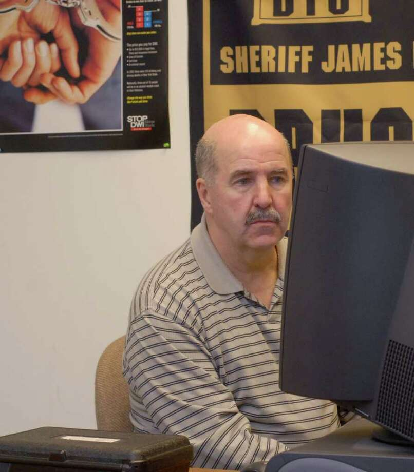 Times Union staff photo by Paul Buckowski ---     Albany County Sheriffs Department, Inspector John Burke works at a computer  at the Albany County Sheriffs Department in Cohoes, NY on Tuesday, Jan. 8, 2008. The department's internal affairs unit is probing Burke's purchase of vehicles that had been traded in by his unit. A comptroller's audit, yet to be made public, states the unit's vehicle purchases have been extravagant and accounted for more than 50 percent of their expenditures of seized criminal assets. Photo: Paul Buckowski / Albany Times Union