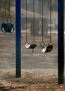 Melted playground equipment is seen in Ranch Crest. Photo: Mayra Beltran, Houston Chronicle / © 2011 Houston Chronicle