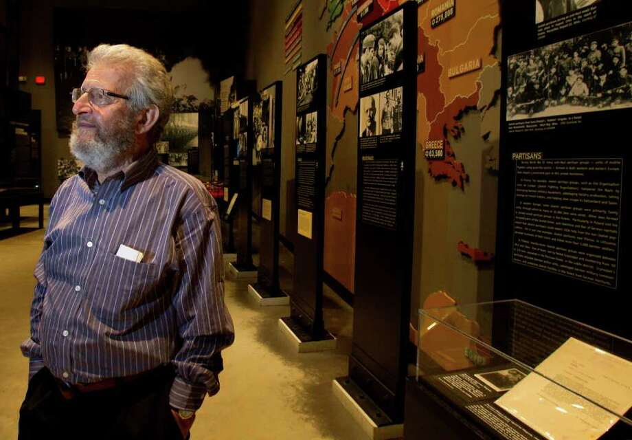 Dieter Heymann, at the Holocaust Museum Houston on  Wednesday, accepted an award in honor of his mother, Erika Heymann, who protected three Jewish men during the Nazi occupation of Amsterdam. (Cody Duty/Chronicle) Photo: Cody Duty, Staff / © 2011 Houston Chronicle