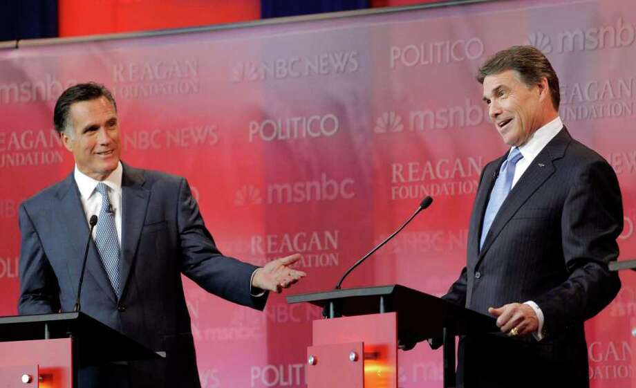 Republican presidential candidates former Massachusetts Gov. Mitt Romney, left, and Texas Gov. Rick Perry answer a question during a Republican presidential candidate debate at the Reagan Library Wednesday, Sept. 7, 2011, in Simi Valley, Calif. Photo: AP