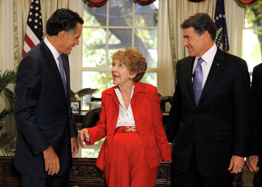 Republican presidential candidates former Massachusetts Gov. Mitt Romney, left, and Texas Gov. Rick Perry, right, meet with former first lady Nancy Reagan before a Republican presidential candidate debate at the Reagan Library Wednesday, Sept. 7, 2011, in Simi Valley, Calif. Photo: Chris Carlson, AP / AP Pool