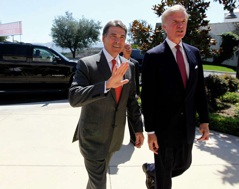Republican president candidate Texas Gov. Rick Perry, left, is met by Frederick J. Ryan, Jr., chairman of the Ronald Reagan President Foundation, as he arrives for a Republican presidential debate at the Reagan Library Wednesday, Sept. 7, 2011, in Simi Valley, Calif. Photo: Chris Carlson, AP / AP