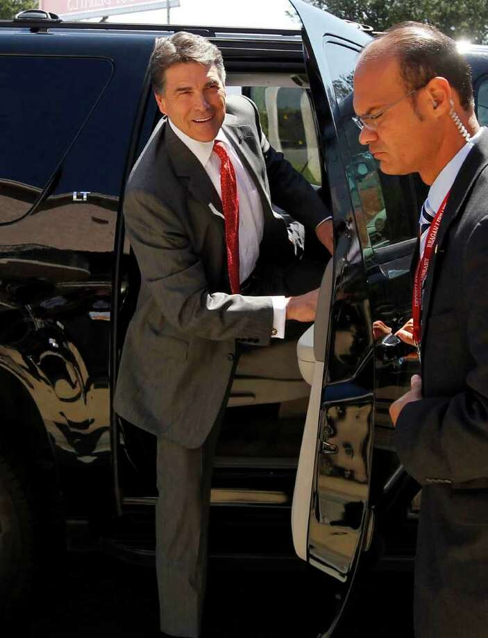 Republican presidential candidate Texas Gov. Rick Perry arrives for a Republican presidential debate at the Reagan Library Wednesday, Sept. 7, 2011, in Simi Valley, Calif. Photo: Chris Carlson, AP / AP