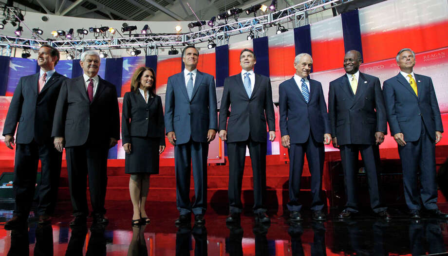 Republican presidential candidates, from left, former Pennsylvania Sen. Rick Santorum, former House Speaker Newt Gingrich, Rep. Michele Bachmann, R-Minn., former Massachusetts Gov. Mitt Romney, Texas Gov. Rick Perry, Rep. Ron Paul, R-Texas, businessman Herman Cain and former Utah Gov. Jon Huntsman stand together before a Republican presidential candidate debate at the Reagan Library Wednesday, Sept. 7, 2011, in Simi Valley, Calif. Photo: Chris Carlson, AP / AP