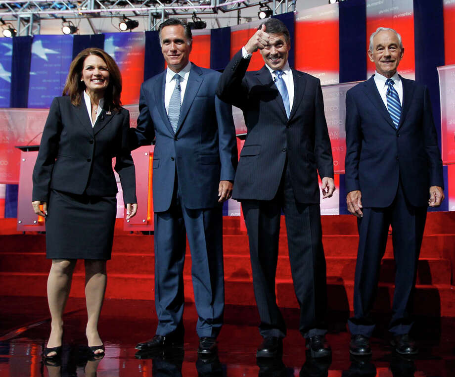 Republican presidential candidates Michele Bachmann, left, Mitt Romney, second from left, Rick Perry, second from right, and Ron Paul stand together before a Republican presidential candidate debate at the Reagan Library Wednesday, Sept. 7, 2011, in Simi Valley, Calif. Photo: Chris Carlson, AP / AP