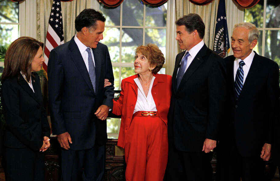Republican presidential candidates are greeted by former first lady Nancy Reagan, center, before a Republican presidential candidate debate at the Reagan Library Wednesday, Sept. 7, 2011, in Simi Valley, Calif. From left are,  Rep. Michele Bachmann, R-Minn., former Massachusetts Gov. Mitt Romney, Reagan, Texas Gov. Rick Perry, and Rep. Ron Paul, R-Texas. Photo: Chris Carlson, AP / AP Pool