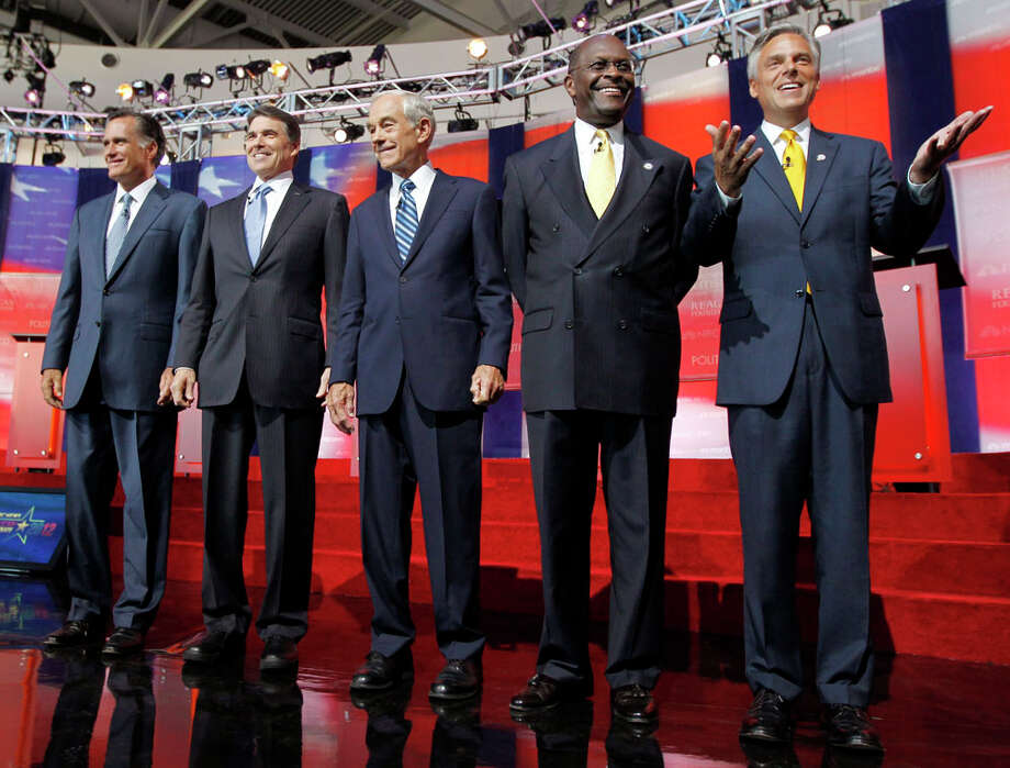 Republican presidential candidates, from left, former Massachusetts Gov. Mitt Romney, Texas Gov. Rick Perry, Rep. Ron Paul, R-Texas, businessman Herman Cain and former Utah Gov. Jon Huntsman stand together before a Republican presidential candidate debate at the Reagan Library Wednesday, Sept. 7, 2011, in Simi Valley, Calif. Photo: Chris Carlson, AP / AP