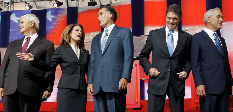 Republican presidential candidates, from left, former House Speaker Newt Gingrich, Rep. Michele Bachmann, R-Minn., former Massachusetts Gov. Mitt Romney, Texas Gov. Rick Perry, and Rep. Ron Paul, R-Texas., stand together before a Republican presidential candidate debate at the Reagan Library Wednesday, Sept. 7, 2011, in Simi Valley, Calif. Photo: Chris Carlson, AP / AP