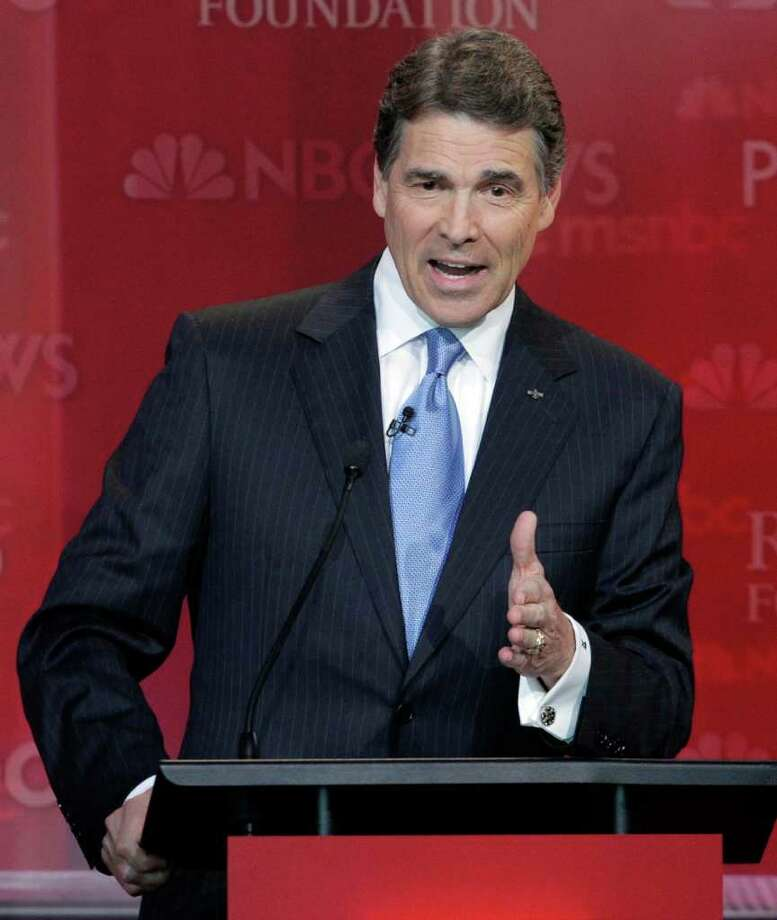 Republican presidential candidate Texas Gov. Rick Perry speaks during a Republican presidential candidate debate at the Reagan Library Wednesday, Sept. 7, 2011, in Simi Valley, Calif. Photo: Jae C. Hong, AP / AP