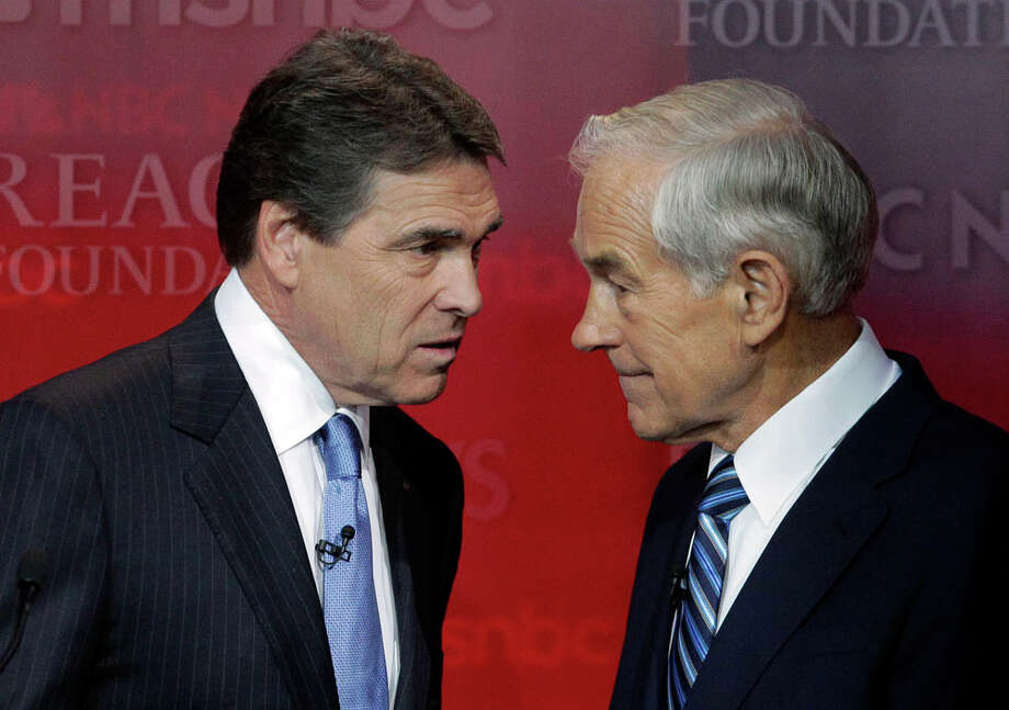 Republican presidential candidates Texas Gov. Rick Perry, left, and Rep. Ron Paul, R-Texas, talk before the start of the Republican presidential candidate debate at the Reagan Library Wednesday, Sept. 7, 2011, in Simi Valley, Calif. Photo: Jae C. Hong, AP / AP