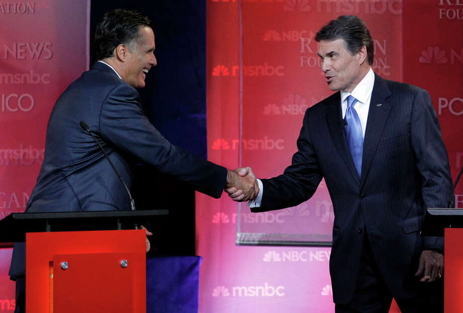 Republican presidential candidates former Massachusetts Gov, Mitt Romney, left, and Texas Gov. Rick Perry shake hands at the finish of a Republican presidential candidate debate at the Reagan Library Wednesday, Sept. 7, 2011, in Simi Valley, Calif. Photo: Jae C. Hong, AP / AP