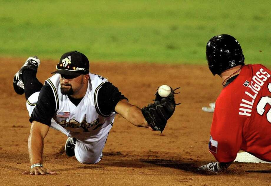 Vince Belnome of the San Antonio Missions reaches for the ball as Mitch Hilligoss of the Frisco Roughriders slides in safely during game one of the Texas League South Division playoffs at Wolff Stadium on Wednesday, Sept. 7, 2011. Hilligoss advanced on a wild pitch. BILLY CALZADA / gcalzada@express-news.net  Frisco Roughriders vs. San Antonio Missions Photo: BILLY CALZADA, Express-News / gcalzada@express-news.net