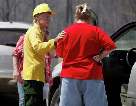 A firefighter comforts a woman as he tells her Wednesday Sept. 7, 2011 she can not return to her home because of fire hot spots in the aftermath of the Bastrop County Complex wildfire that charred more than 33,000 acres. Photo: WILLIAM LUTHER, William Luther/wluther@express-news.net / 2011 SAN ANTONIO EXPRESS-NEWS
