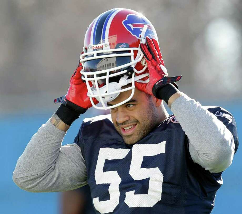 Buffalo Bills' Shawne Merriman puts on his helmet at the start of NFL football practice in Orchard Park, N.Y., Wednesday, Nov. 10, 2010. Merriman  limped off the field with a lower right leg injury shortly after opening his first practice with his new team. (AP Photo/David Duprey) Photo: David Duprey / AP