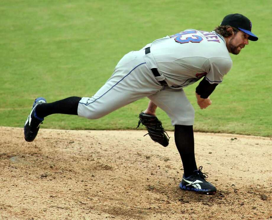 MIAMI GARDENS, FL - SEPTEMBER 07:  Pitcher R.A. Dickey #43 of the New York Mets throws against the Florida Marlins at Sun Life Stadium on September 7, 2011 in Miami Gardens, Florida.  (Photo by Marc Serota/Getty Images) Photo: Marc Serota