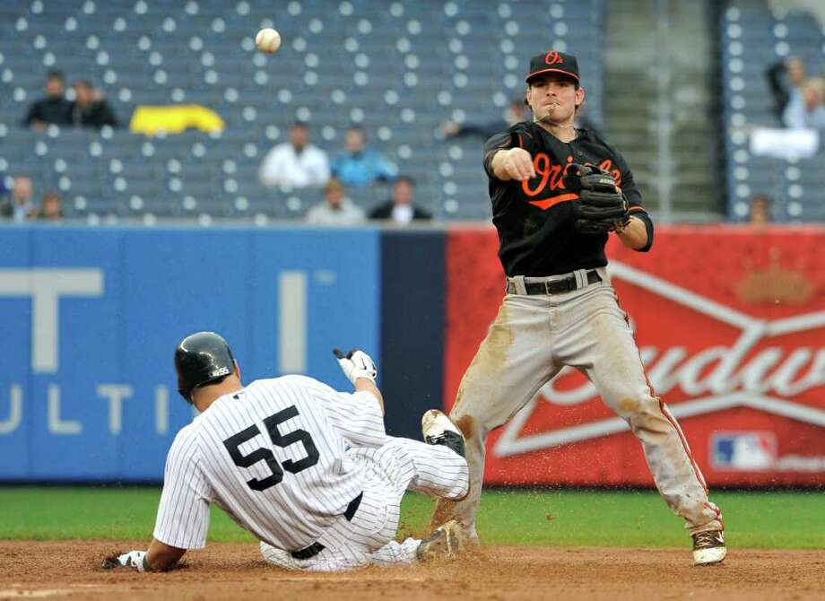 New York Yankees' Russell Martin (55) is forced out at second base by Baltimore Orioles second baseman Ryan Adams in the 10th inning of a baseball game on Wednesday, Sept. 7, 2011, at Yankee Stadium, in New York. (AP Photo/Kathy Kmonicek) Photo: Kathy Kmonicek