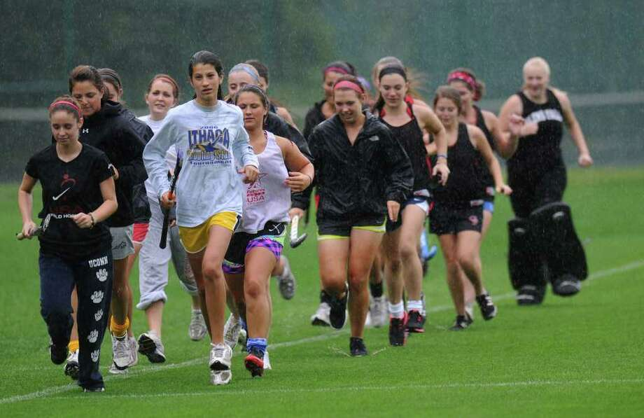The Glens Falls High School field hockey team runs in the rain, led by Hannah Hayward, left, and Jill Rizzo, right, on Wednesday Sept. 7, 2011 in Glens Falls, NY.  ( Philip Kamrass / Times Union) Photo: Philip Kamrass / 00014519A