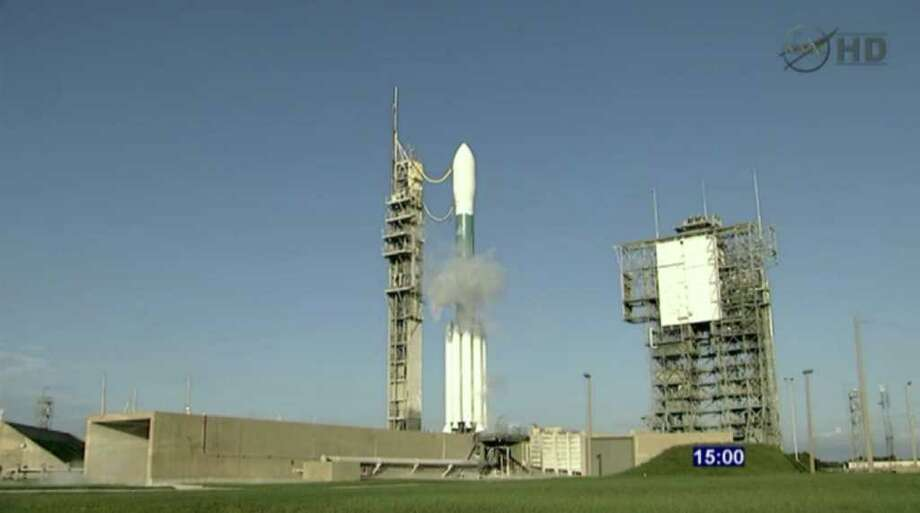 This framegrab image from NASA-TV shows the twin GRAIL satellites sitting on launch pad 37-A at the 15-minute hold mark atop a United Launch Alliance Delta II rocket Thursday Sept. 8, 2011. NASA is sending the probes on a long, roundabout trip to the moon. The spacecraft will orbit the moon, chasing one another in circles so researchers can measure the gap and the gravity below. It will be the first lunar mission devoted to studying the insides of the moon. By measuring the entire gravity field of the moon, scientists hope to learn what the moon is made of all the way to its core. (AP Photo/NASA) Photo: HOPD / NASA