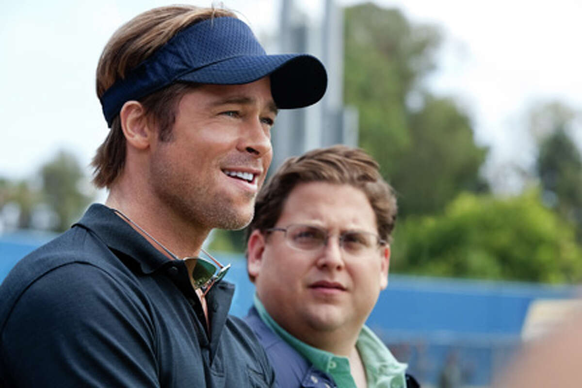 (L-R) Brad Pitt as Billy Beane and Jonah Hill as Peter Brand in