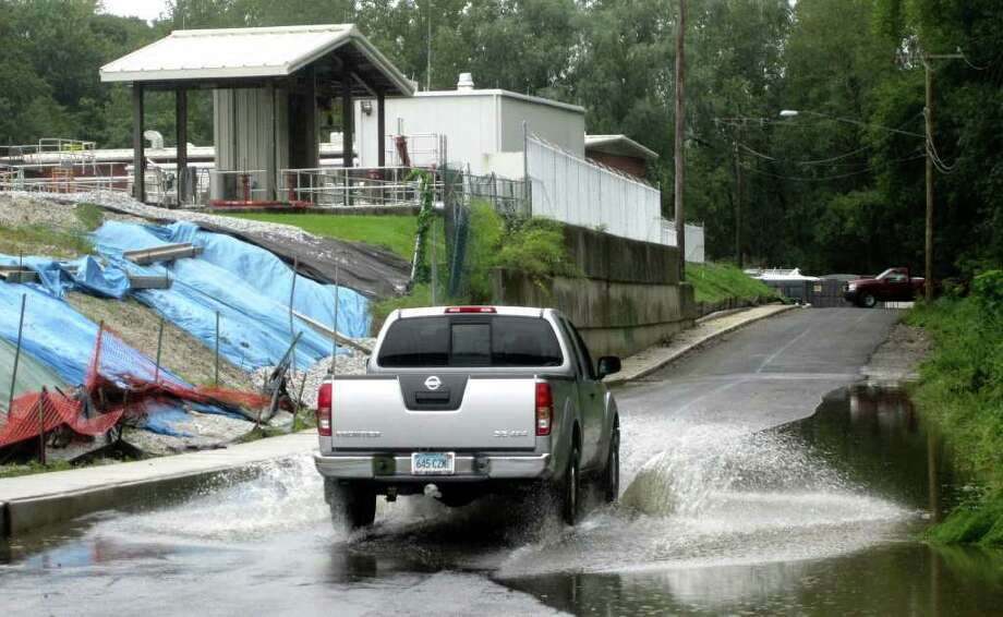 SPECTRUM/A significant hurdle for building  marketable condos at the south end of West Street could be the low lying stretch of the street often flooded by the nearby Housatonic River, even by moderate rainfalls. Sept. 7, 2011 Photo: Norm Cummings