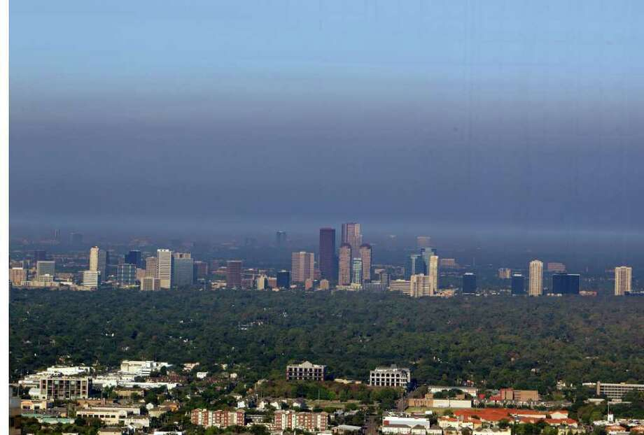 A smokey haze from wildfires hangs over the Galleria area skyline Thursday, Sept. 8, 2011, in Houston. ( James Nielsen / Chronicle ) Photo: James Nielsen, Staff / © 2011 Houston Chronicle