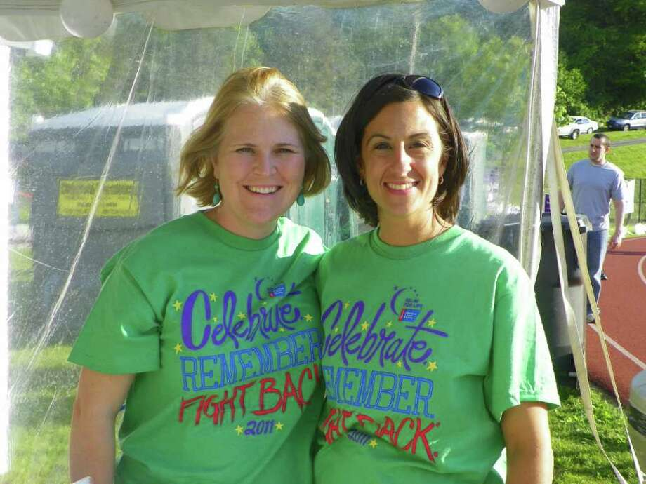 New Fairfield teacher Kristen Scappaticci, right, is shown here with her friend Becky Finnerty, online chair of the Relay for Life committee. Photo: Contributed Photo