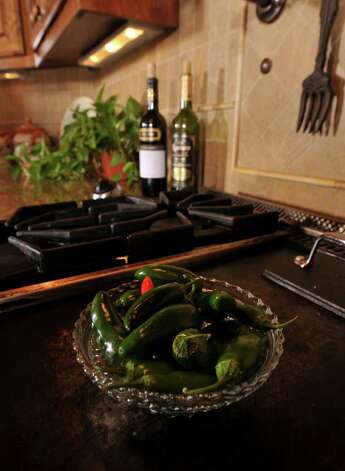Jalapeno's decorate the stove top. Photo: Photo By Robin Jerstad/Special To The Express-News / Copyright 2011 by Robin Jerstad