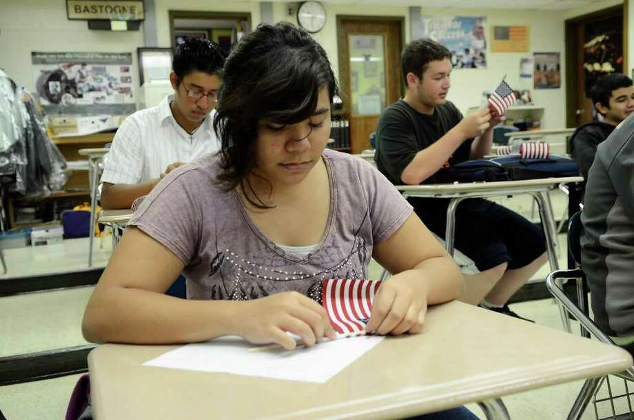Airah Roda, 15,, a JROTC cadet, prepares a flag for a planned Friday ceremony commemorating 9/11 at Westhill High School in Stamford, CT on Thursday, September 8, 2011. Photo: Shelley Cryan / Shelley Cryan freelance; Stamford Advocate freelance