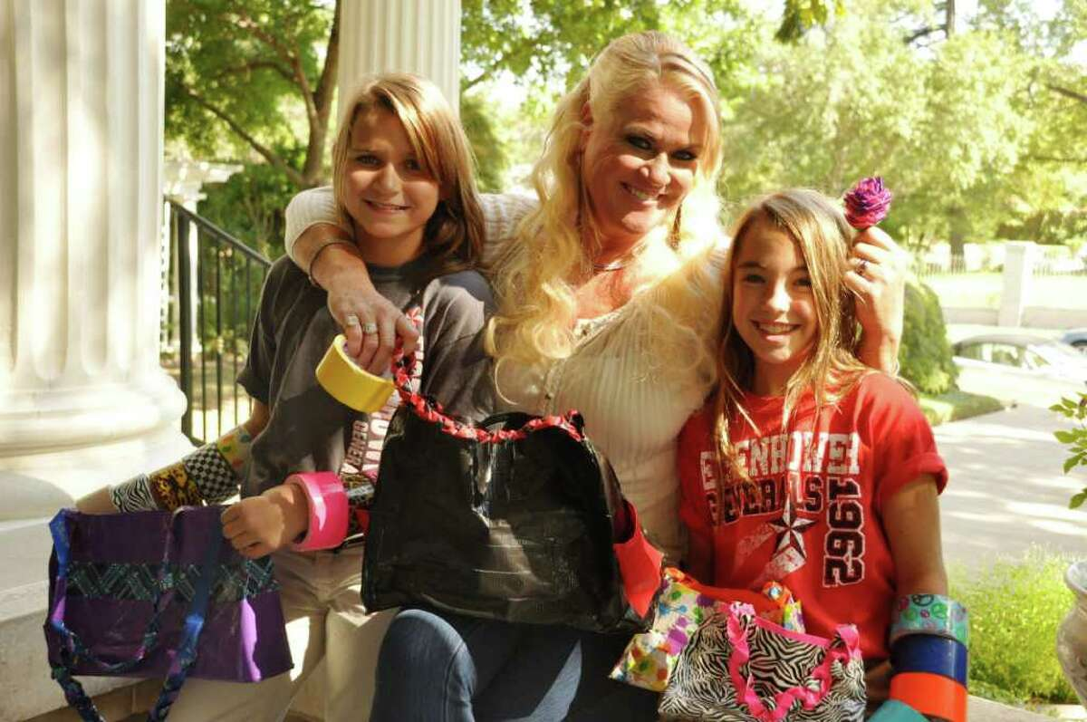 Kym Rapier poses with Devyn Darmstetter (right) and her best friend Lauren Hawthorn, Eisenhower Middle School students who craft duct tape accessories under the business name Devyn and Lauren Creations. They donate proceeds to a Rapier family charity, Kym's Kids.