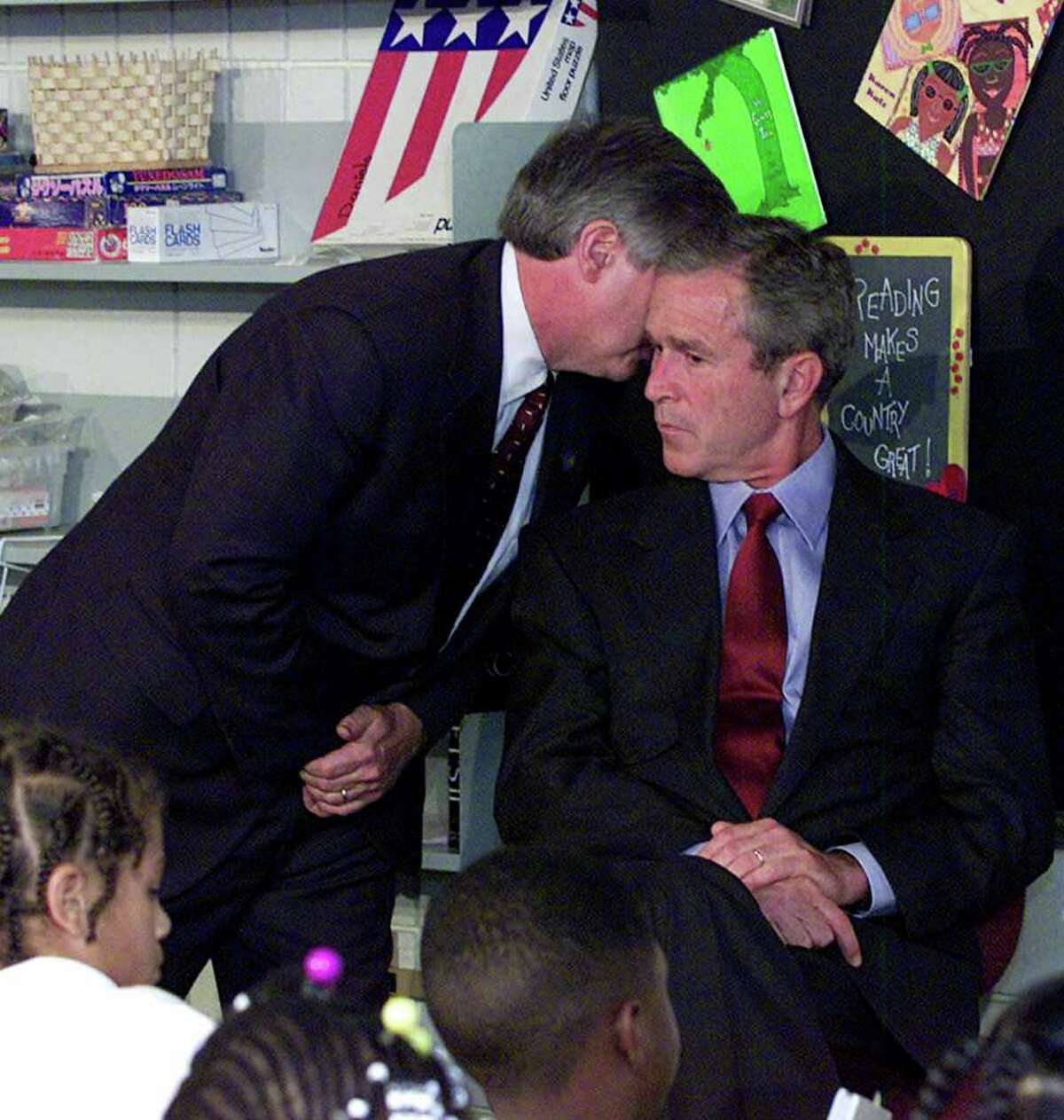 FILE - In this Tuesday, Sept. 11, 2001 file photo, Chief of Staff Andy Card whispers into the ear of President George W. Bush to give him word of the plane crashes into the World Trade Center, during a visit to the Emma E. Booker Elementary School in Sarasota, Fla. (AP Photo/Doug Mills, File)