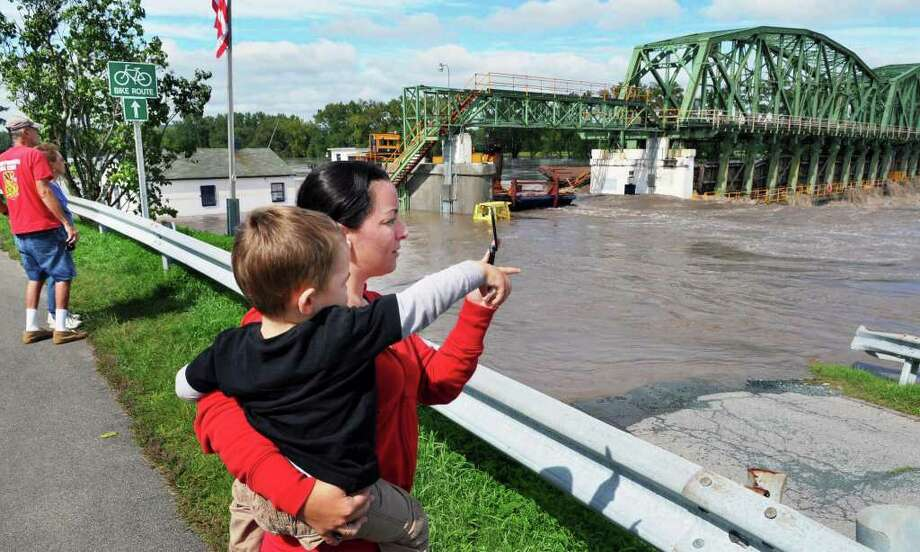 Valerie Laurence of Rotterdam and her son Ethan check out flood waters at Lock 8 on the Mohawk River Thursday Sept. 08, 2011.  (John Carl D'Annibale / Times Union) Photo: John Carl D'Annibale