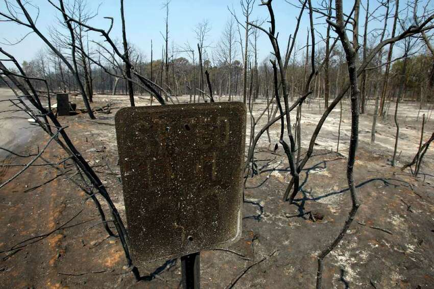 The remains of a fire-charred speed limit sign is seen Wednesday Sept. 7, 2011 in the Alum Creek area east of Bastrop aftermath of the Bastrop County Complex wildfire that charred more than 33,000 acres.