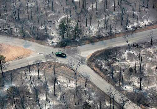 A Texas Parks and Wildlife vehicle is seen at an intersection in this Tuesday Sept. 6, 2011 aerial image taken over the wildfires in the Bastrop, Texas area. Photo: William Luther/wluther@express-news.net / wluther@express-news.net