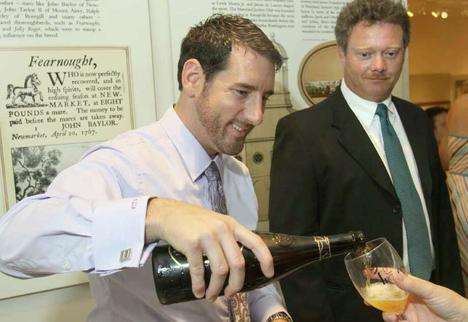 Saratoga Springs, NY - August 26, 2011 - (Photo by Joe Putrock/Special to the Times Union) -Executive Director at Food Pantries for the Capital District, Inc. Benji Fox pours some Brooklyn Lager during the 13th Annual Travers Wine Tasting to benefit Senior Services of Albany's Meals on Wheels and other senior programs. Photo: Joe Putrock / Joe Putrock